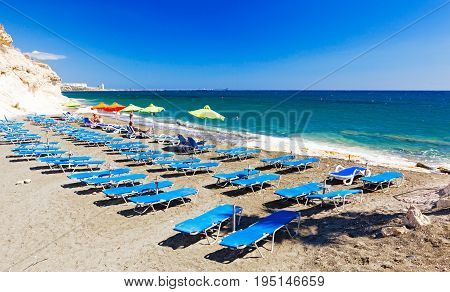 CYPRUS PENTAKOMO- SEPTEMBER 22 2016: rows of blue sunbeds on Kalymnos Beach.