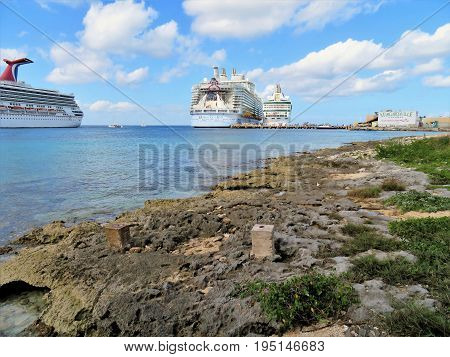 Cozumel Mexico - January 19 2017: cruise ships Hamony of the Seas Rhapsody of the Seas and Carnival Glory docked at the port of Cozumel Mexico