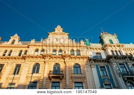 Riga, Latvia. Facade Of Old Art Nouveau Building Designed By Mikhail Eisenstein On 13 Alberta Street, Currently Houses Graduate School Of Law. Sunny Day Under Blue Sky. UNESCO World Heritage Site