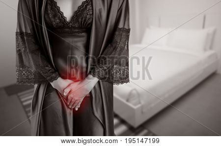 The woman in purple satin sleepwear and robe wake up for go to restroom. People with urinary bladder problem concept