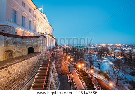 Tallinn, Estonia. Building Of Government Of Republic Of Estonia, Old Stone Staircase And Cityscape At Winter Evening Night. View From Patkuli Viewpoint. Traditional Old Ancient Architecture.