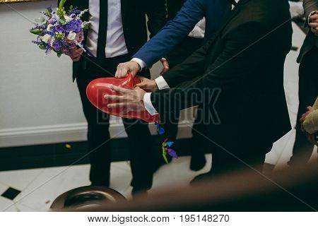 The groom breaks the ball at the wedding
