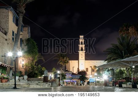 Tel Aviv -Yafo Israel July 08 2016: Kdumim square and St. Peter's Church with the Clock Tower at night in old city Yafo Israel.
