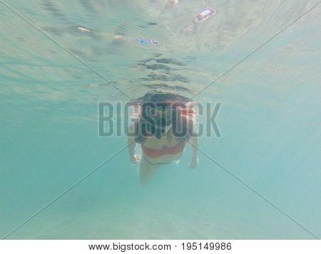 Brunette woman snorkelling underwater