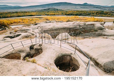 Uplistsikhe, Shida Kartli Region, Georgia. Remnants Of Altar In Famous Landmark Uplistsikhe Is An Ancient Rock-hewn Town In Eastern Georgia. Landscape In Sunny Autumn Day. UNESCO  World Heritage Site.