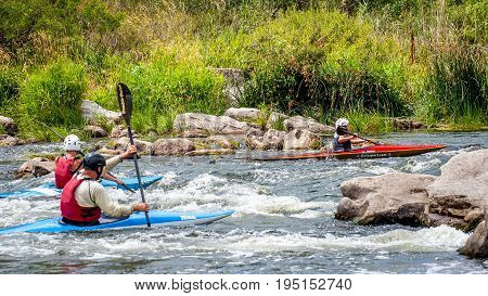 The village of Mihia Ukraine - July 9 2017. A teenager trains in the art of kayaking. Boat boats on untreated river rapids. The child skillfully engaged in rafting under the control of parents.