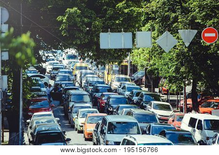 Road traffic congestion on a city road. A car with a high load. The problem of urban infrastructure.
