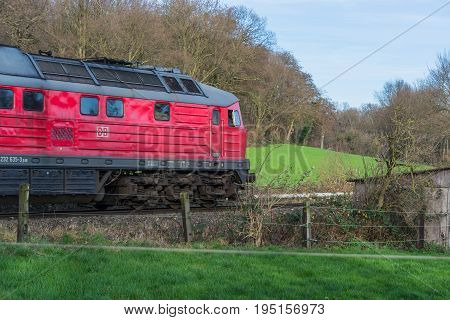 RATINGEN NRW GERMANY - DECEMBER 28 2015: Locomotive at the railroad crossing in Ratingen at the moated castle