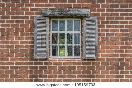 Beautiful window and brick wall. Have clipping path on window's glass