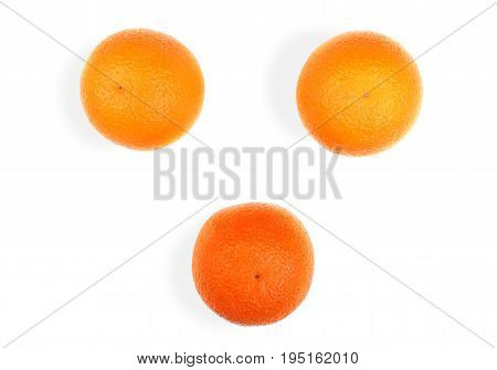 Three big ripe juicy oranges, isolated on a white background. Citrus fruits. Set of fresh orange fruits, close-up. Exotic and tropical fruits. Fresh, bright and juicy oranges.