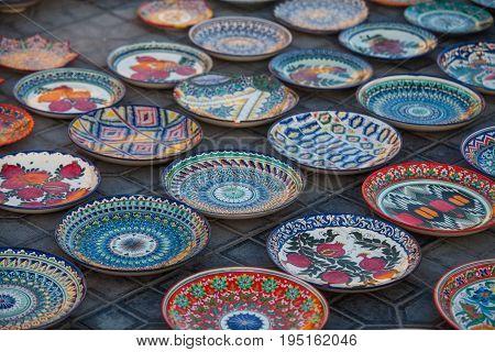 Color image of some handmade Uzbekistan plates for sale.