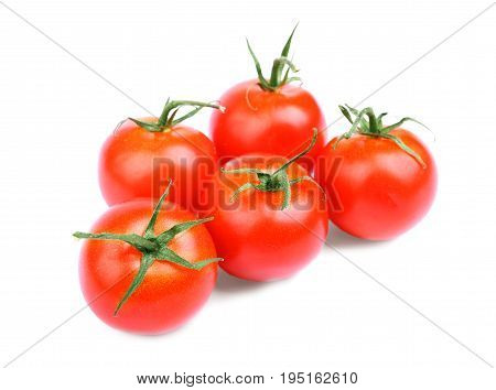 Whole, ripe, juicy, fresh and organic bright red tomatoes with leaves. A lot of an organic, juicy, fresh, healthful bright red tomatoes, isolated on a white background.