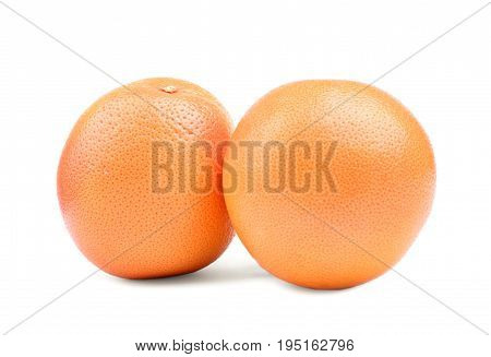 Two big ripe juicy and organic oranges, isolated on a white background. Close-up of two juicy and ripe oranges. Fresh, bright and juicy oranges. Ripe citrus fruits. Orange fruits.