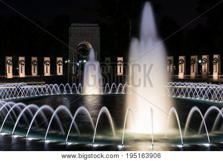 World War 2 memorial and fountains at night in Washington DC