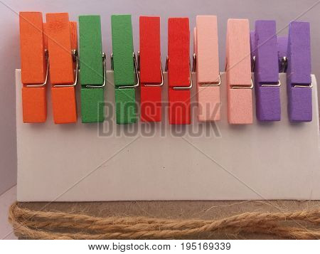 Clothes pegs 3. Five pairs of wooden clothes pegs placed horizontally