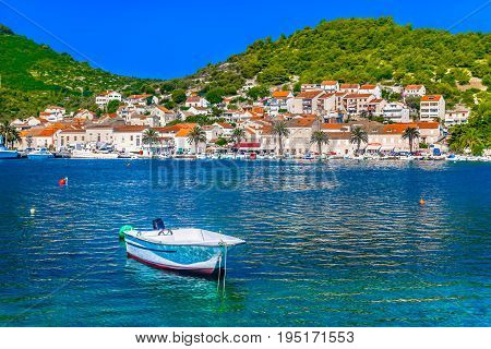 Seafront view at famous summer tourist resort of mediterranean village on Island Vis, Croatia.