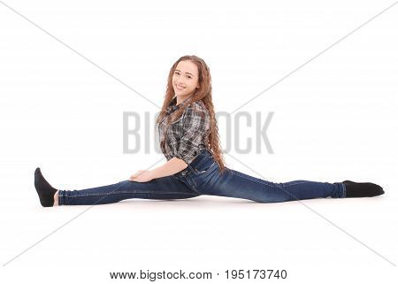 Girl in jeans sitting on twine isolated on white