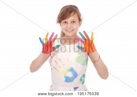 Portrait of adorable smiling little girl with the colored hands and dress isolated on a white background