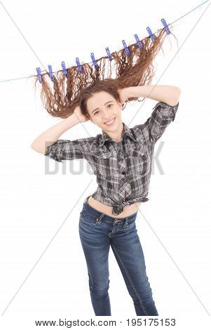 Girl drying her hair on a rope. Isolated on white.