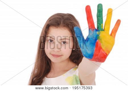 Portrait of adorable smiling little girl with the colored hands and dress isolated on a white background. Close-up