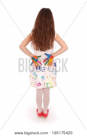 Adorable smiling little girl with the colored hands and dress isolated on a white background
