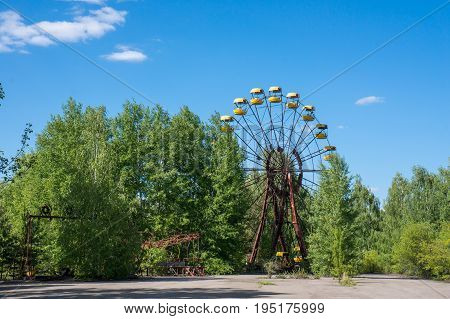An abandoned ferris wheel in Pripyat close to Chernobyl where the nuclear catastrophy occured in 1986.