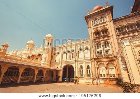 MYSORE, INDIA - FEB 17, 2017: Historical arches and tower of the royal Palace of Mysore built in 1912 on February 17, 2017. With population 900000 Mysore is the cultural capital of Karnataka