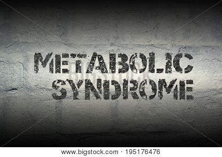 metabolic syndrome phrase stencil print on the grunge white brick wall