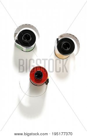 Rolls of dia positive films isolated on white background.
