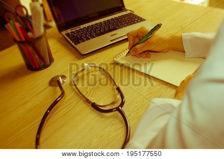 Medicine doctor's working place. Shot of female medical doctor's hands. Healthcare and medical concept - Retro color