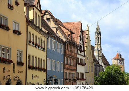 ROTHENBURG OB DER TAUBER, GERMANY - JUNE 10, 2017: Visiting Rothenburg ob der Tauber, one of the oldest and most historic of the medieval towns along the Romantic Road, Germany on June 10, 2017.