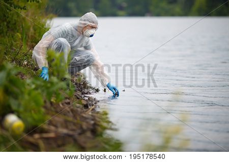 Biologist with bulb on river