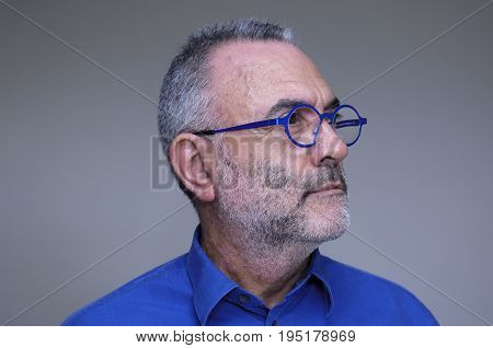 Middle-aged Man With Blue Shirt And Glasses