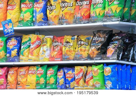 MELBOURNE AUSTRALIA - JUNE 30, 2017: Snacks and crisps sold at a convenience store.