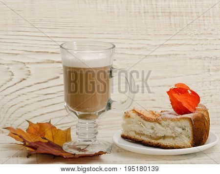 Apple Pie And Cappuccino On A Wooden Background