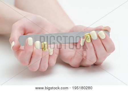 Nail File In Female Hands, Place For Text. White Background