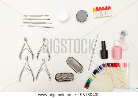 Set For Manicure. Tools, Nippers, Nail Polish, Coating, Tassel And Palette. White Background, Top Vi