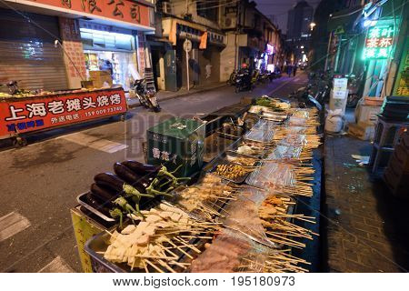 SHANGHAI CHINA - MARCH 18: Street food at Nanjing Road on March 18 2016 in Shanghai China. Nanjing Road is the main shopping street of Shanghai and is one of the world's busiest shopping streets.
