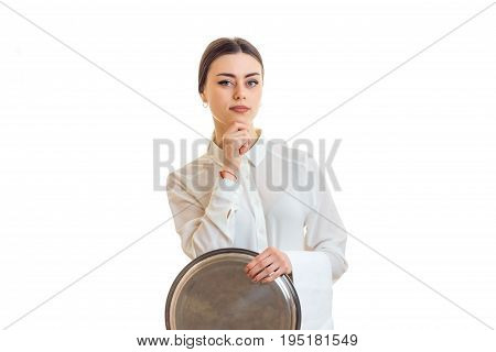serious girl waitress in uniform with trey in hands isolated on white background