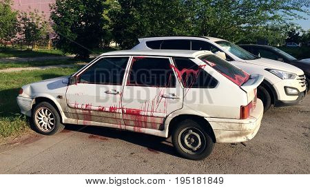 Vandalism - a modern car, doused with paint in free parking in city