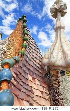 BARCELONA SPAIN - MAY 11 2016: Casa Batllo housetop details with ceramic mosaic. Building redesigned in 1904 by Gaudi located in the center of Barcelona it is on the UNESCO World Heritage Site