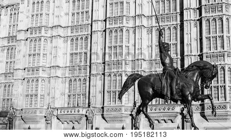 London UK - February 23 2016: Richard the FirstRichard The Lionheart Monument at The Houses of Parliament in LondonEngland