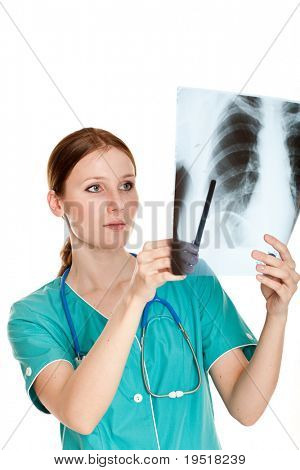 Young female doctor looking at the xray picture