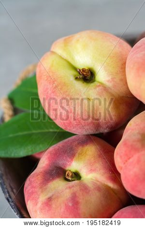 Fresh Ripe Chinese Flat Saturn Peaches With Leaves