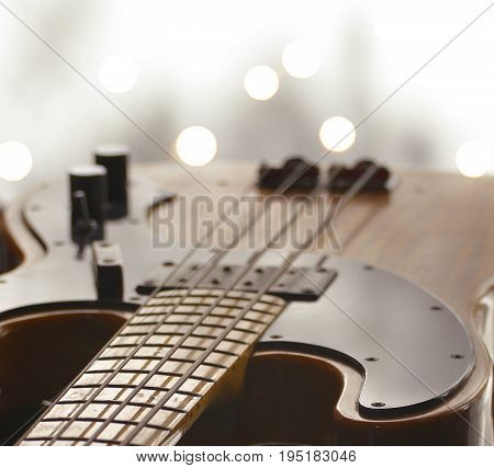 An electric bass guitar photographed with a shallow depth of field and a bokeh background