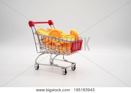 Shopping Cart Filled With Yellow Coins.