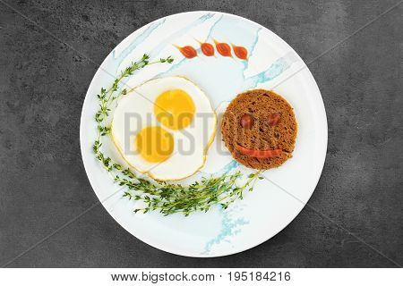Delicious breakfast with sunny side up eggs on table