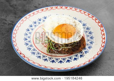 Delicious breakfast with sunny side up egg on table