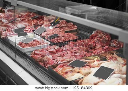 Fresh meat in cooled display in supermarket