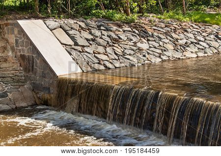 Weir on a river. Corrected trough on a rural river in the Czech Republic